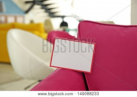 Pink armchair for sale in furniture store