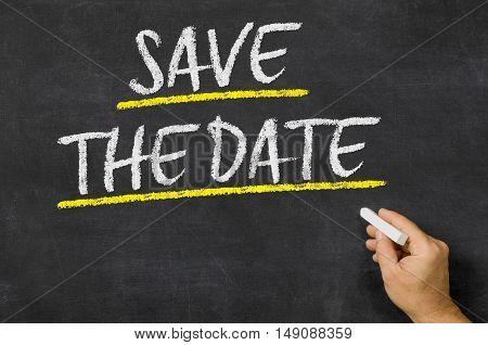 Save The Date Written On A Blackboard