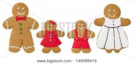 Gingerbread Family On A White Background  Decorated With Fondant Icing