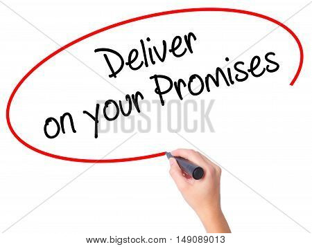 Women Hand Writing Deliver On Your Promises With Black Marker On Visual Screen
