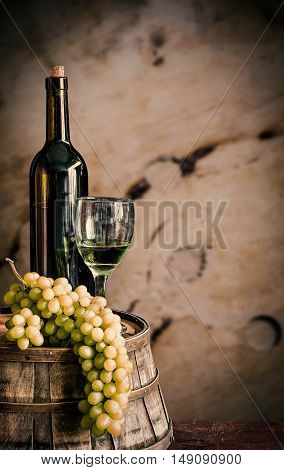 Grapes and wine on the old wooden barrels.