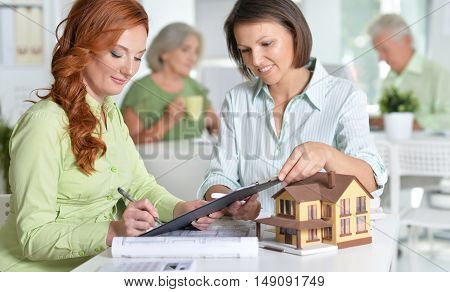 Portrait Of working business people In Office , Female house agent and customer