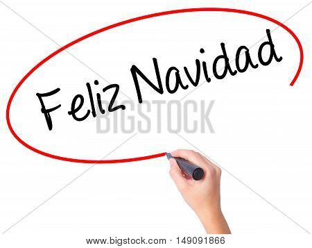 Women Hand Writing Feliz Navidad  (merry Christmas In Spanish) With Black Marker On Visual Screen