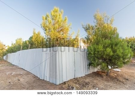 Construction Fence In A Forest