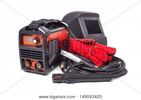 Inverter welding machine, welding equipment isolated on white background leather gloves, high-voltage wires with clips, set of accessories for arc welding