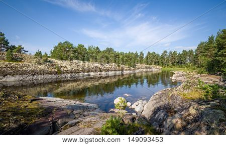 Small bay between the rocky shores of Karelian islands. Republic of Karelia, Russia.