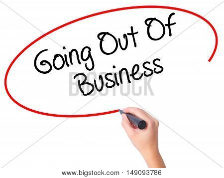 Women Hand Writing Going Out Of Business With Black Marker On Visual Screen
