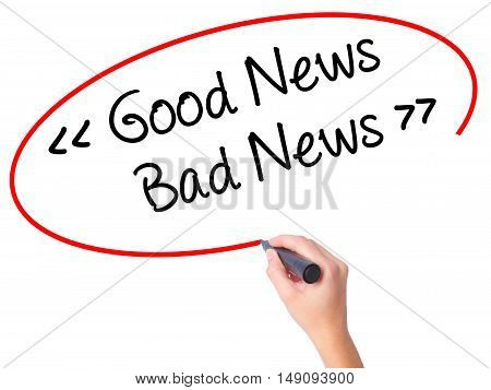 Women Hand Writing Good News - Bad News With Black Marker On Visual Screen.