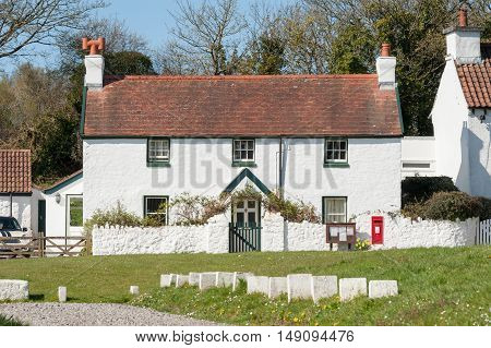 PENRICE, WALES, UK - APRIL 17: Bay View Cottage, built in the 18th century and part of the historic Penrice Castle Estate, a popular tourist destination near Penrice, Wales, UK on April 17, 2016