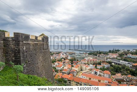 Funchal ancient fortress walls and cityscape view. Madeira island, Portugal.