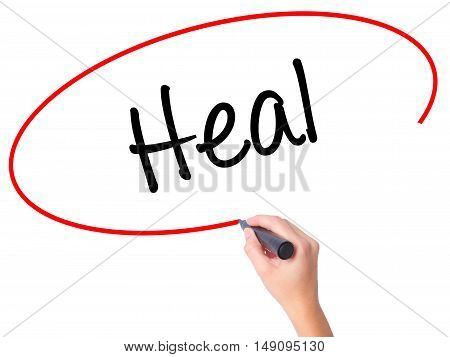 Women Hand Writing  Heal  With Black Marker On Visual Screen