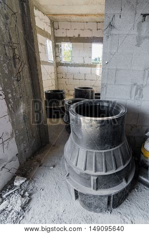 Sewage Equipment Inside A Brick And Concrete House Under Construction