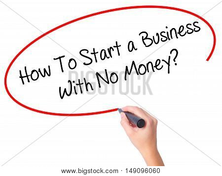 Women Hand Writing How To Start A Business With No Money? With Black Marker On Visual Screen