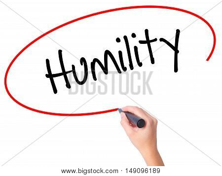 Women Hand Writing Humility  With Black Marker On Visual Screen.