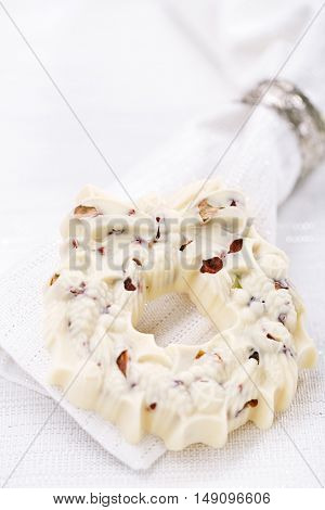 white chocolate festive christmas wreath on table with glitter napkin