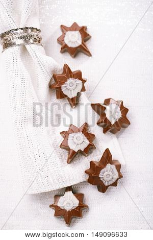 dark chocolate festive christmas star sweets on table with glitter napkin