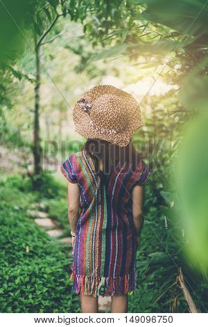 walk woman forest garden away leave walkway green trip travel traveler girl person rural back journey rear outdoor foliage natural step spring vivid tree bright grass female grove young plant nature go ground