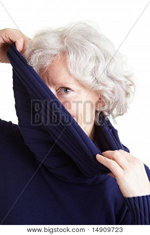 Elderly Woman Holding Turtleneck Sweater