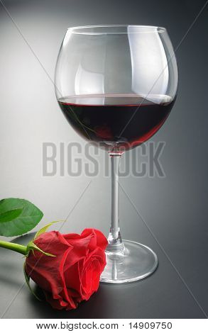 Glass Of Red Wine And Rose Flower