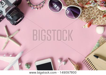 Outfit of traveler on pink background with copy space Travel concept