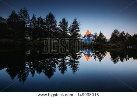 Morning panorama with famous peak Matterhorn in alpine valley. Popular tourist attraction. Dramatic and picturesque scene. Location place Swiss alps, Grindjisee, Valais region, Europe. Beauty world.