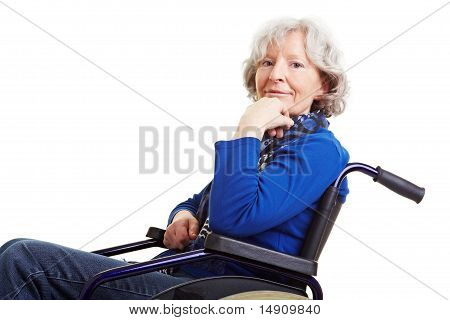 Smiling Retired Woman In Wheelchair