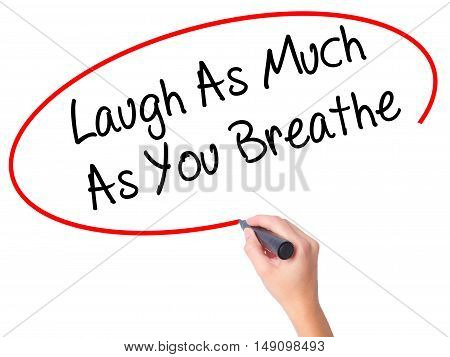 Women Hand Writing Laugh As Much As You Breathe With Black Marker On Visual Screen.
