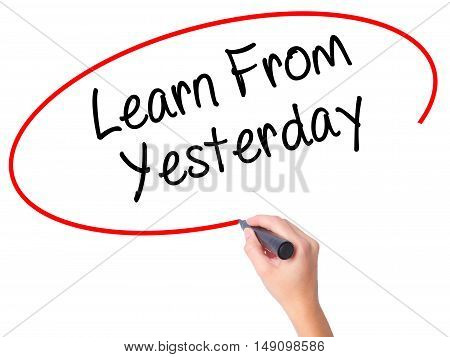 Women Hand Writing Learn From Yesterday With Black Marker On Visual Screen