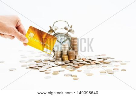 Coins Stack And Hand Holding The Card,finance Concept On White Background And Selective Focus.