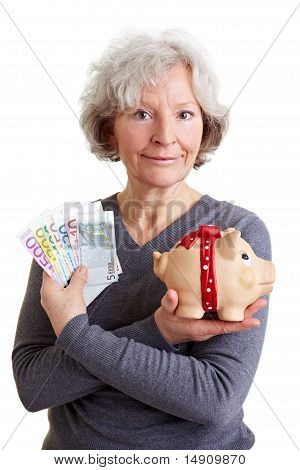 Senior Woman With Euro Money And Piggy Bank