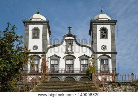 Old cathedral with two bell towers near the entrance of Monte park in Funchal. Madeira island, Portugal.