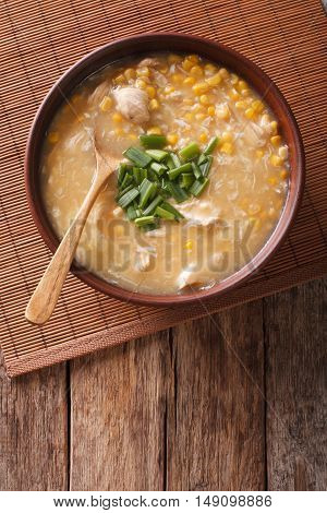 Chinese Food: Corn Soup With Chicken And Onions Close-up. Vertical Top View