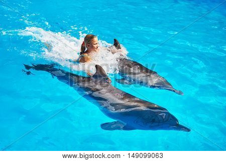 Girl Swims With Dolphins In Pool