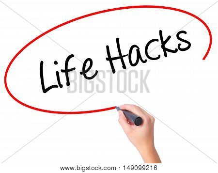 Women Hand Writing Life Hacks With Black Marker On Visual Screen
