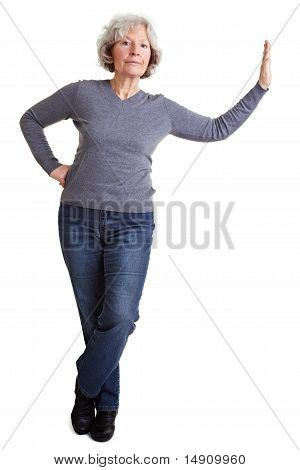 Senior Woman Leaning On Imaginary Wall