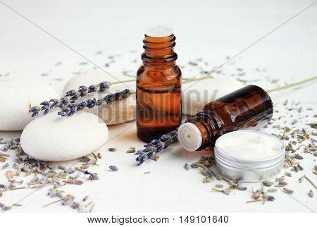 Essential Lavender oil based cosmetic. Aroma bottles, lavender, skincare cream.