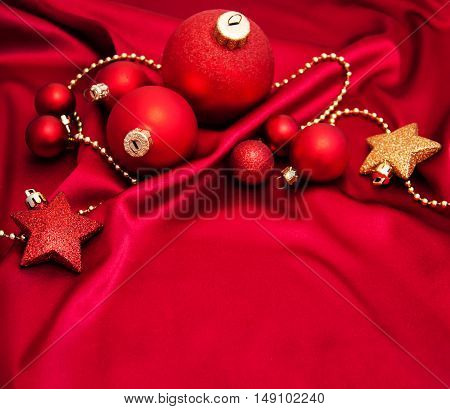 Christmas Baubles On The Red Silk