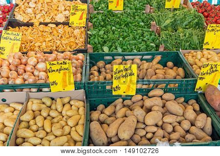 Potatoes and other vegetables for sale at a market