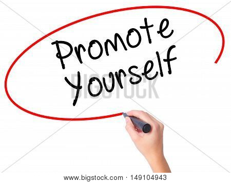 Women Hand Writing Promote Yourself With Black Marker On Visual Screen