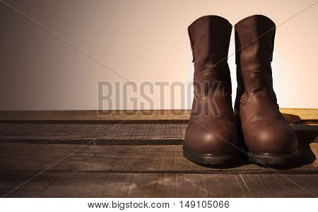 safety boots on wooden background and prepare for work, tools equipment for protection worker in hard work, Personal protective equipment in industry job.