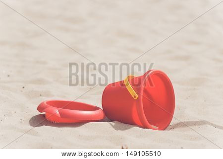 Sandbox With A Red Bucket