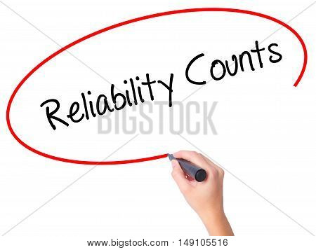 Women Hand Writing Reliability Counts With Black Marker On Visual Screen