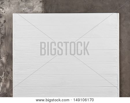 Grey stucco and white wooden patterns