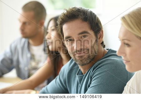 Smiling relaxed businessman attending meeting