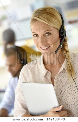 Closeup of customer service manager standing in call center