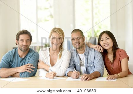 Ethnic people in business room