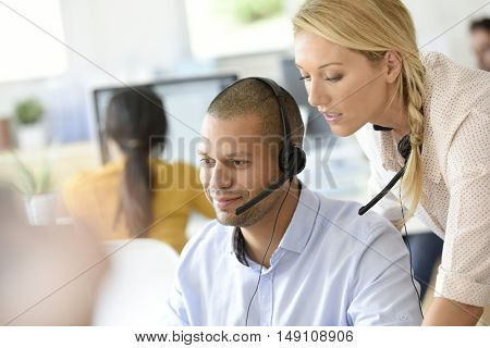 Teleoperator in office with manager