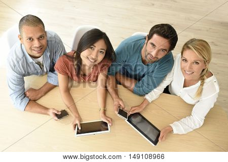 Upper view of start-up business people meeting with electronic devices