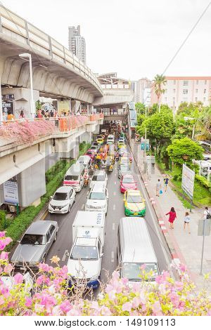 Bangkok Thailand - June 5 2016 : Side view of sky train road at station and a lot of traffic on Payathai road (under) near Victory monument.