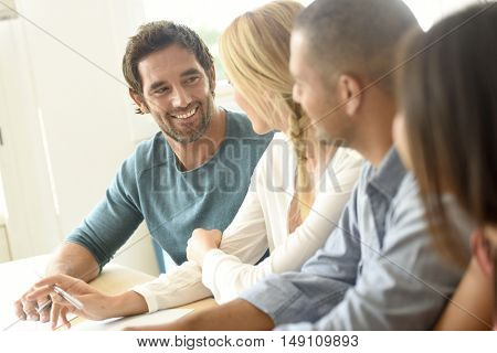 Group of young ethnic business people in meeting